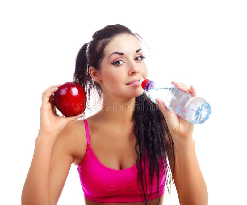 Girl drinking water stock image