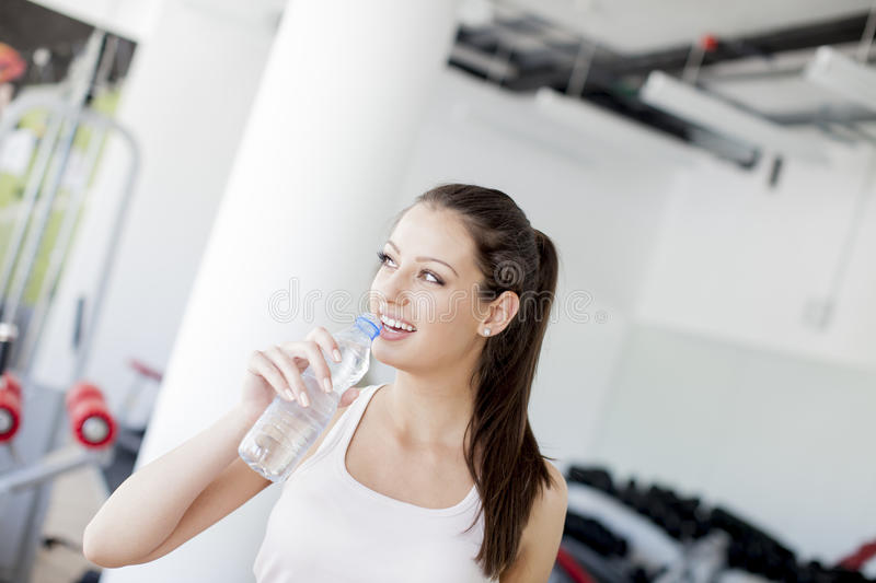 Download Girl Drinking Water In The Gym Stock Image - Image: 25087503