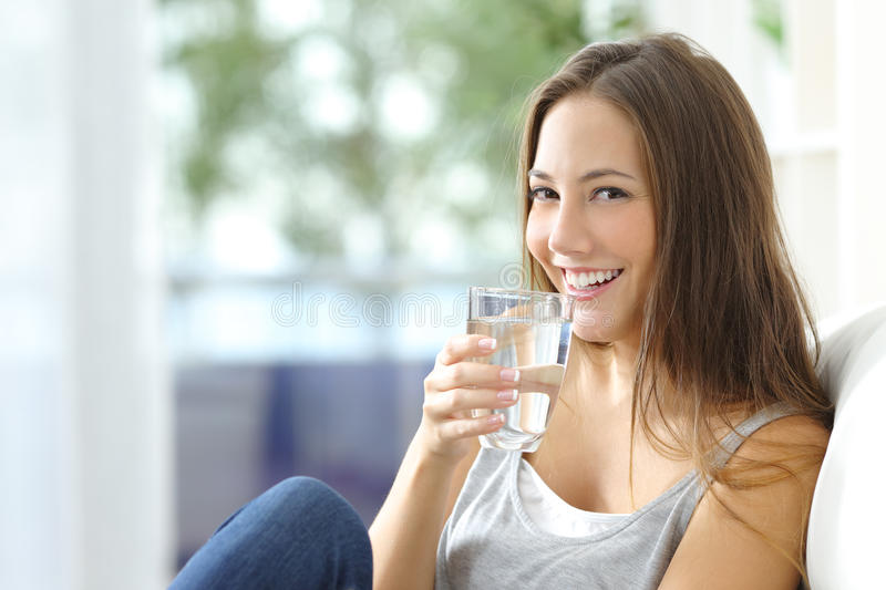 Download Girl Drinking Water At Home Stock Photo - Image of fresh, beverage: 64827840