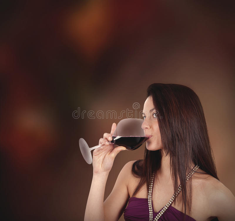 Girl drinking wine stock image