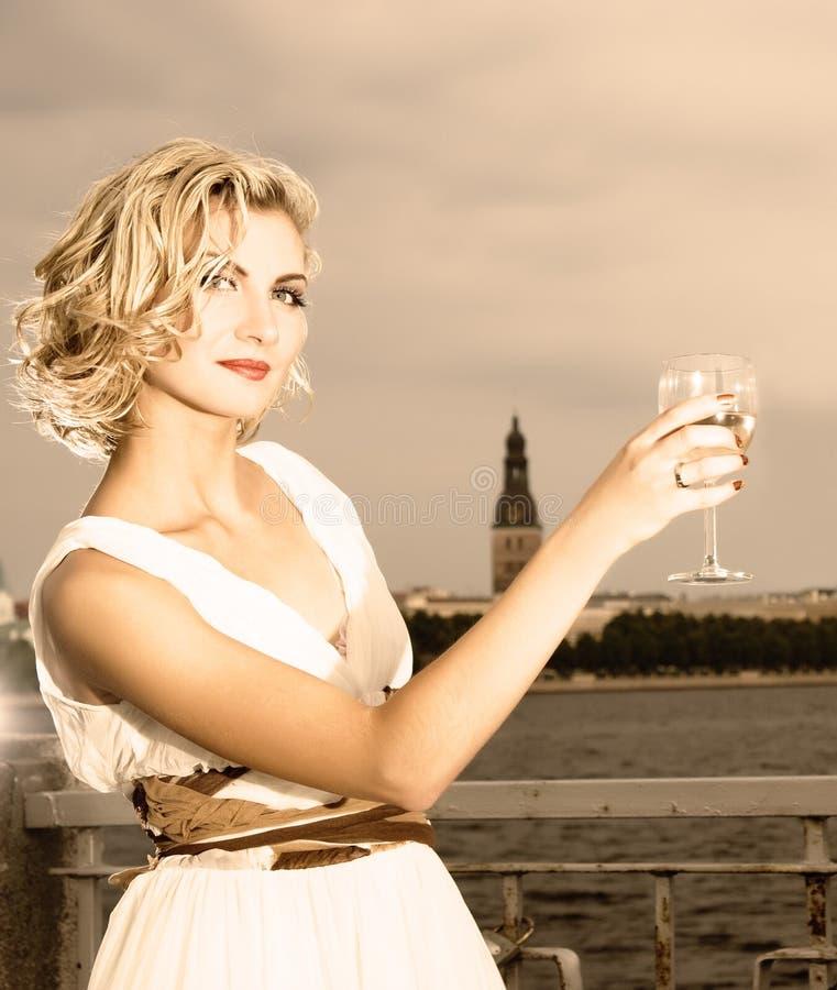 Girl Drinks Champagne Stock Photo