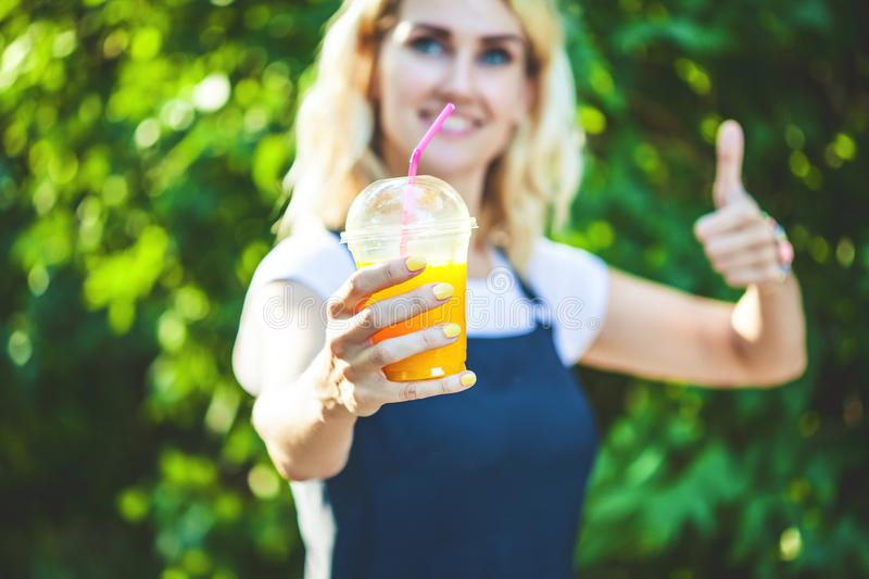 A girl drinks freshly squeezed juice, a healthy lifestyle stock image