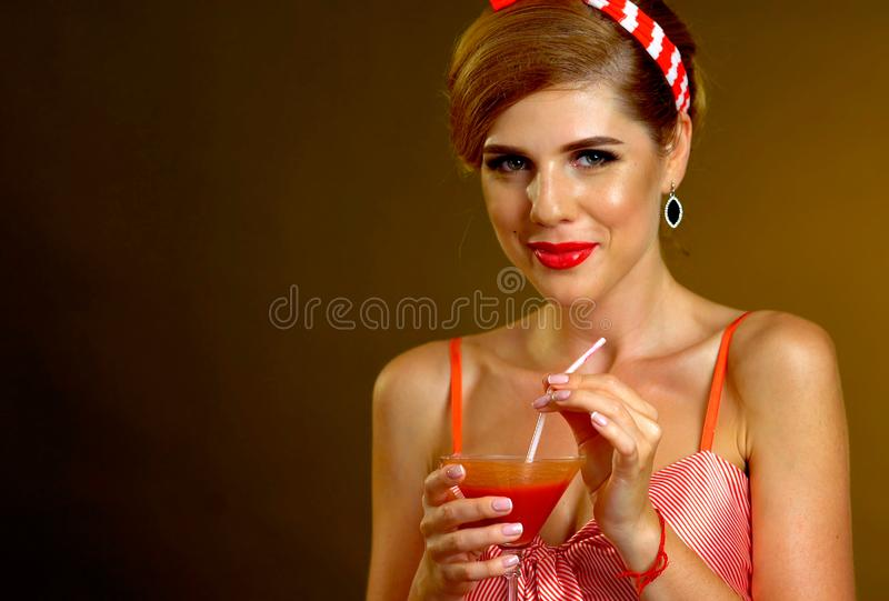 Girl drinks martini cocktail. Woman on thematic party retro style. Girl drinks martini cocktail. Woman on thematic party retro old fashioned style royalty free stock photo