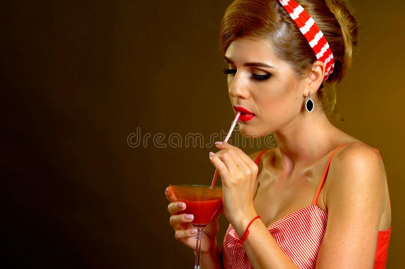 Girl drinks martini cocktail. Woman on thematic party retro style. Girl drinks martini cocktail. Woman on thematic party retro old fashioned style. Than quench royalty free stock image