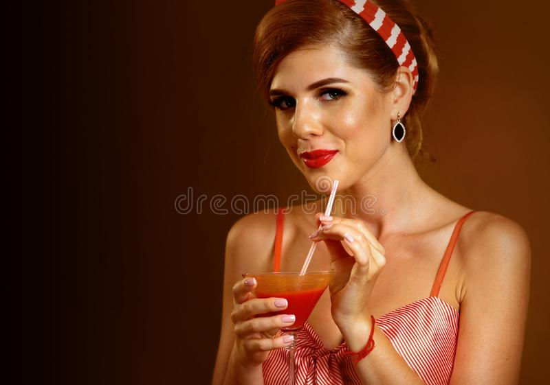 Girl drinks martini cocktail. Woman on thematic party retro style. Girl drinks martini cocktail. Woman on thematic party retro old fashioned style. Organization royalty free stock photo