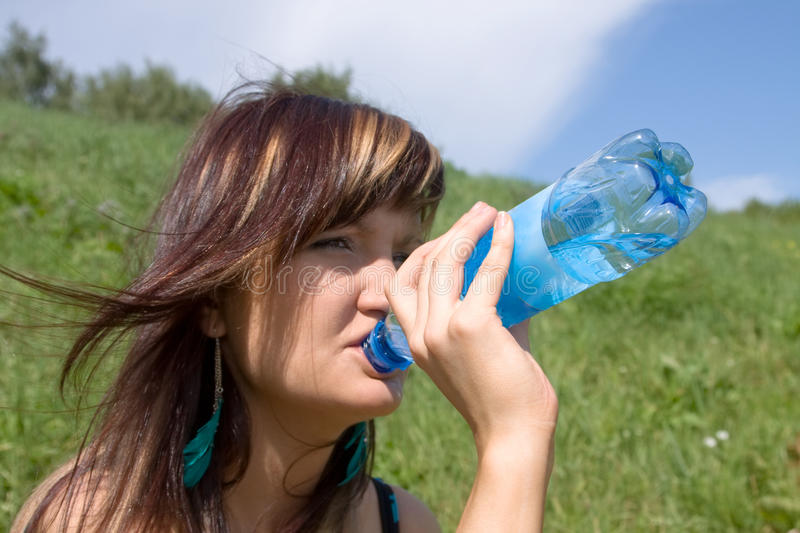 Download The Girl Drinks Mineral Water From A Bottle Stock Photo - Image: 15379796