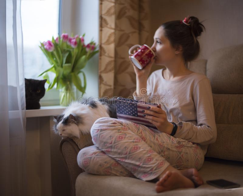 Girl drinks tea and dreams of spring royalty free stock photo