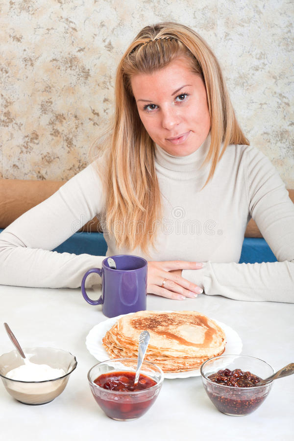 Download Girl Drinks Tea And Eats Russian Pancakes Stock Image - Image: 22993087