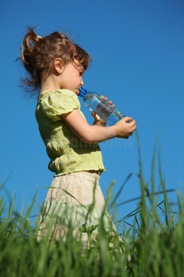 Download Girl Drinks Water From Plastic Bottle Stock Photo - Image: 10354556