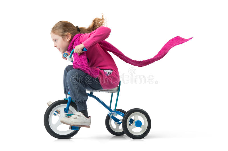 Girl drives a bicycle on white royalty free stock photography