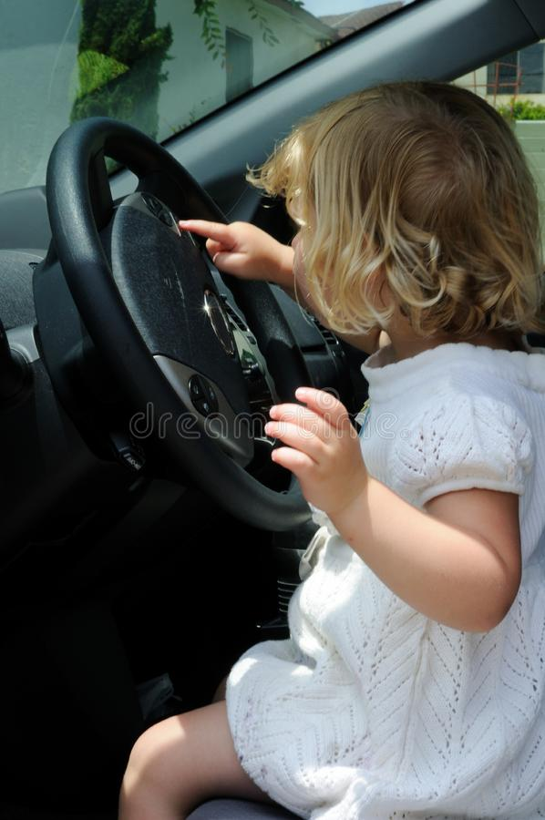 Girl driving a car royalty free stock photography