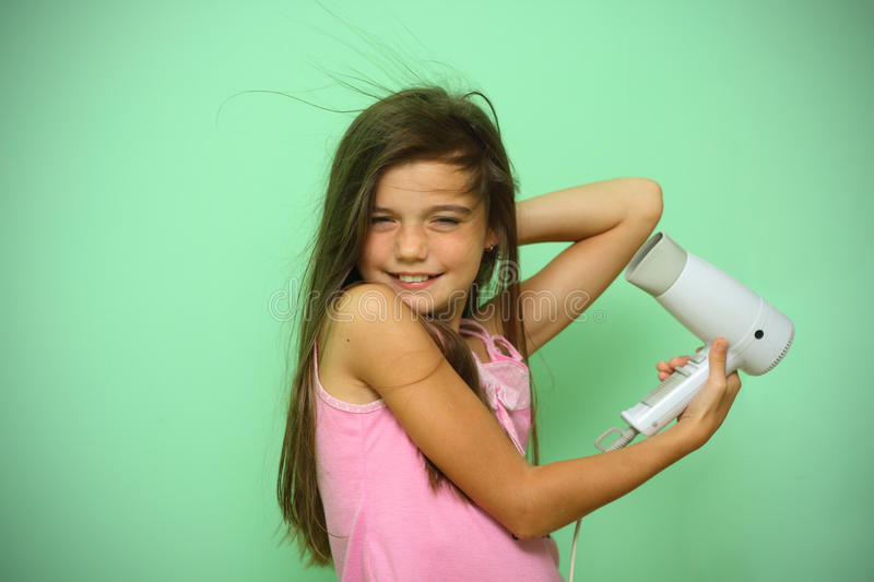 Download Girl dry his hear stock image. Image of beauty, dryer - 21213717
