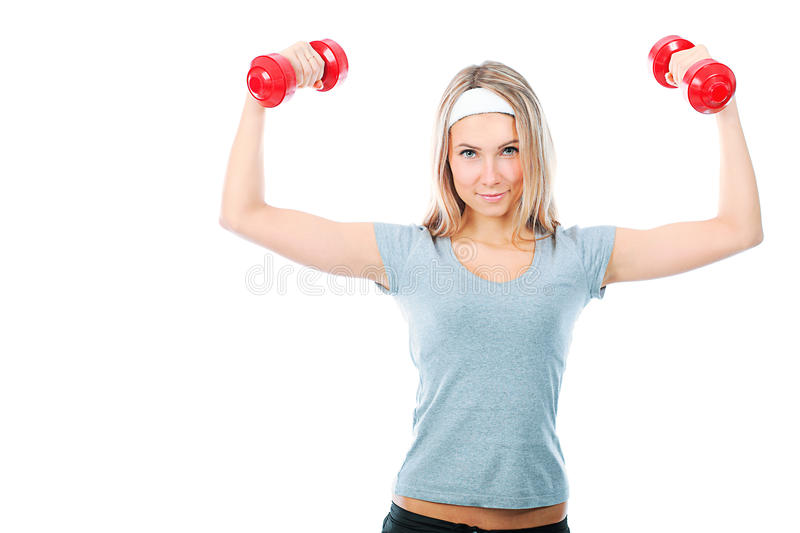 Girl with dumbbells royalty free stock images