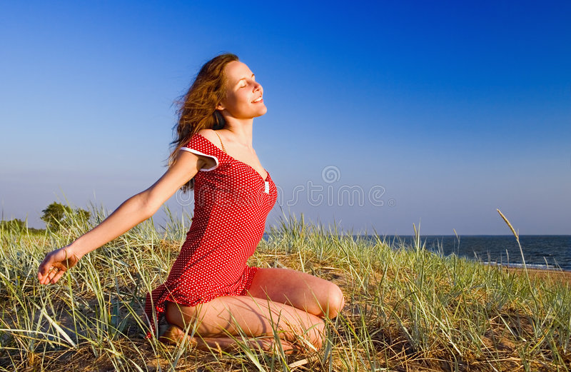 Girl on a dune-2 stock images