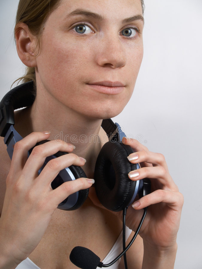 Download The girl in ear-phones stock photo. Image of face, girl - 6956720