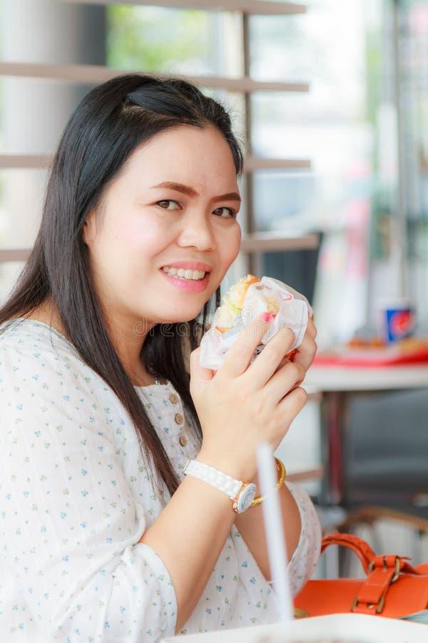 Girl Eat Hamburger. Asia girl eat hamburger in the restaurant stock photos