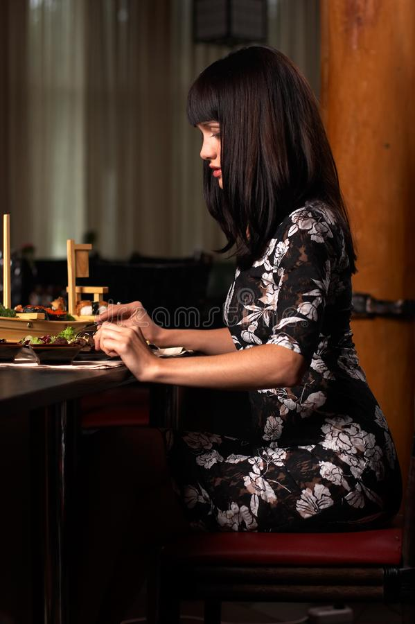 The girl eat sushi 2 royalty free stock image