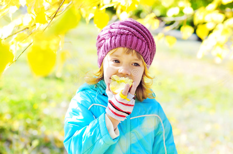 Download Girl eating apple stock image. Image of golden, cheerful - 23374555