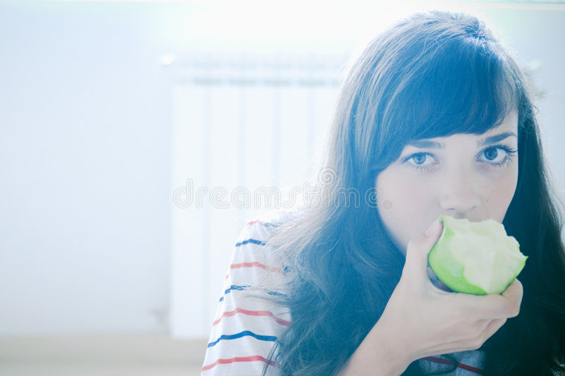 Download Girl eating apple stock image. Image of consuming, consumes - 2713113