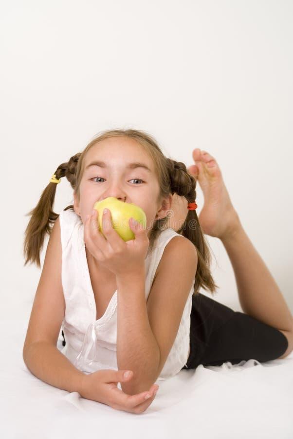 Download Girl eating apple II stock image. Image of young, yellow - 2923951