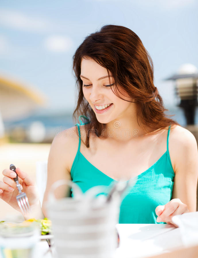 Download Girl Eating In Cafe On The Beach Royalty Free Stock Photography - Image: 34108117