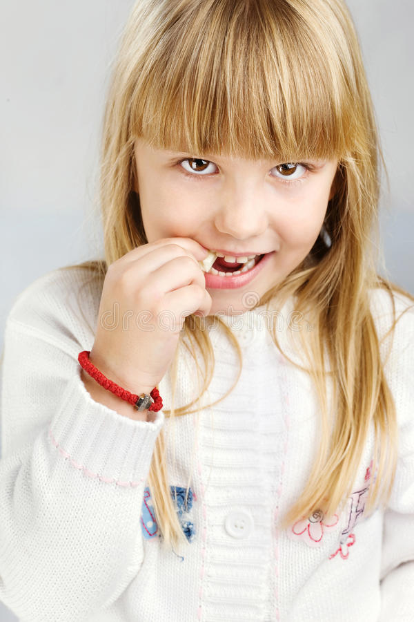 Download Girl eating candy stock photo. Image of look, smile, joyful - 22575596