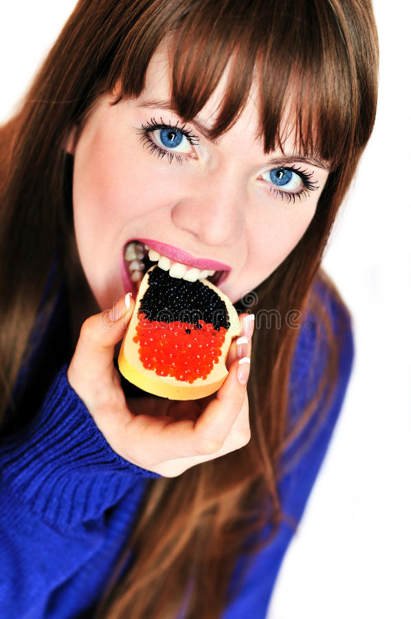 Girl eating caviar stock image