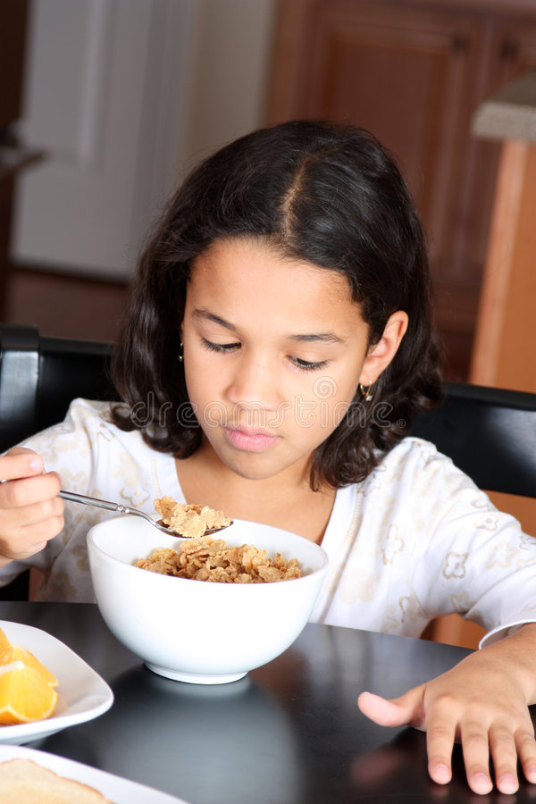 Girl Eating Cereal stock images