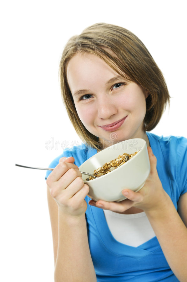Girl eating cereal royalty free stock photography