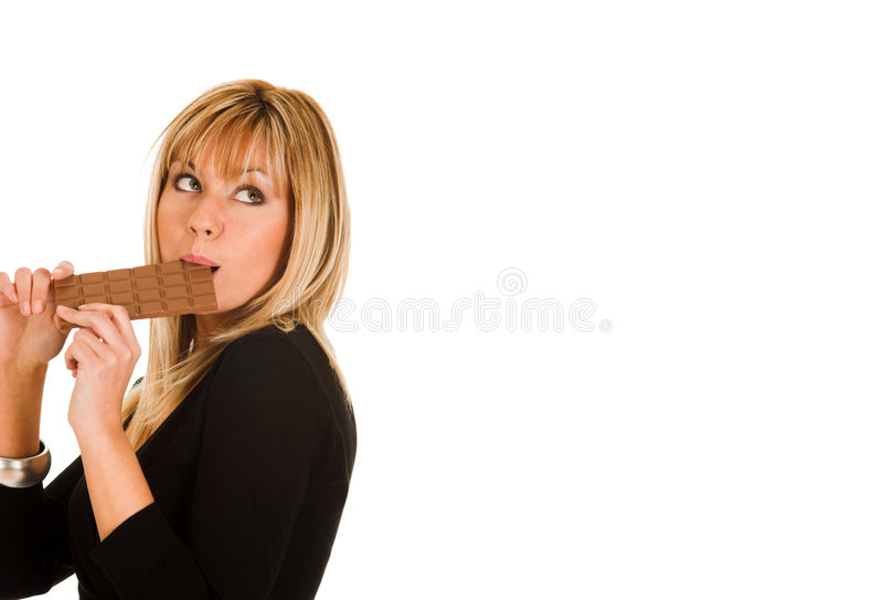Girl eating chocolate stock photography