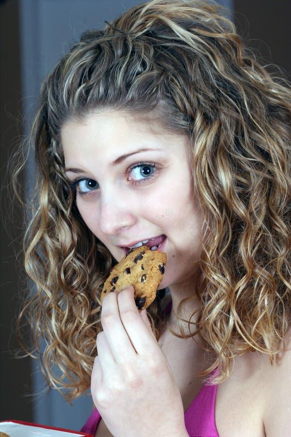 Download Girl Eating Chocolate Cookie Stock Photo - Image of cookies, sweet: 8537326