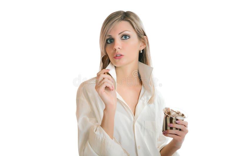 Girl eating chocolate paste isolated on white. Background royalty free stock photo