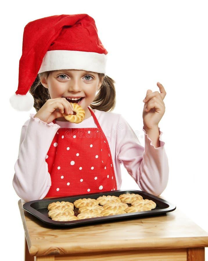 Download Girl Eating Christmas Cookies Royalty Free Stock Photo - Image: 26613395