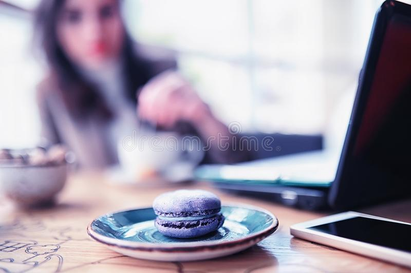 Girl eating coffee cakes. And drinking coffeer stock photos