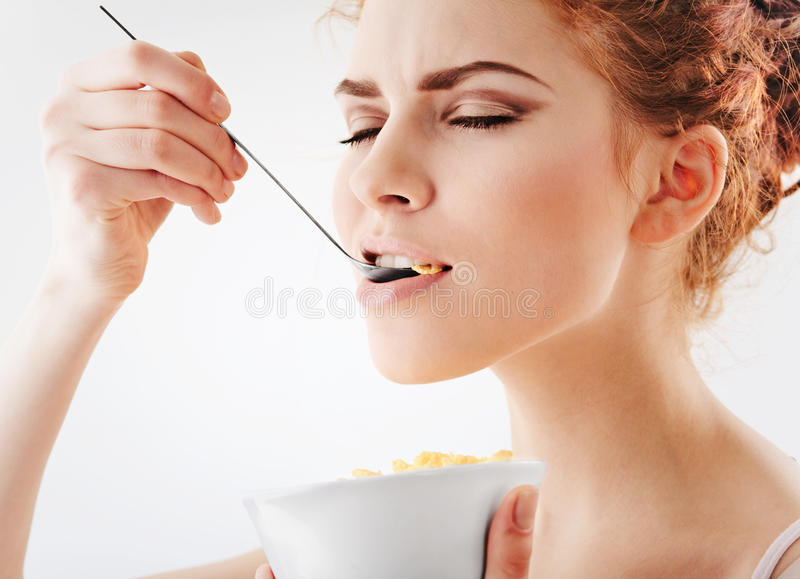 Download Girl eating corn flakes stock photo. Image of hair, ceramics - 13558590