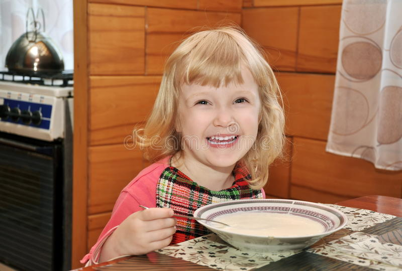 Girl Is Eating Cream Of Wheat Stock Image