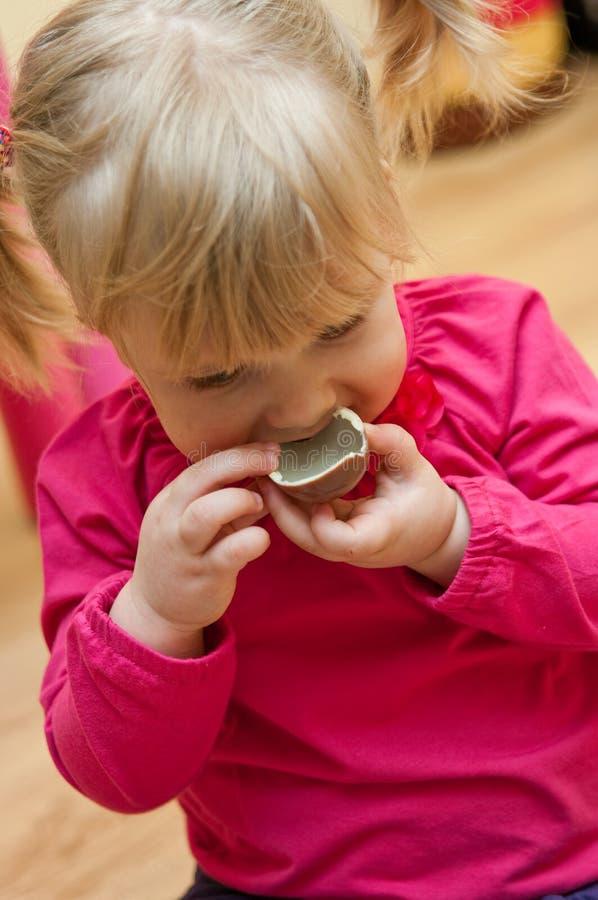 Girl Eating Easter Egg Stock Image