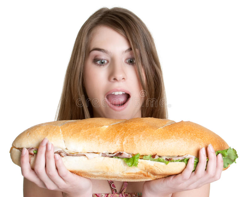 Girl Eating Food. Isolated girl eating sandwich food royalty free stock images