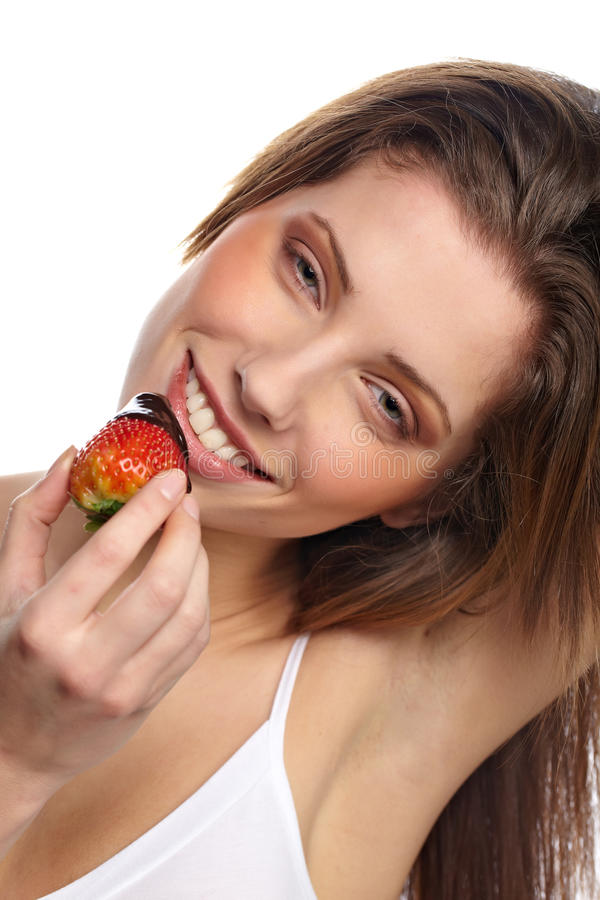 Girl Eating A Fresh Red Strawberry Stock Images