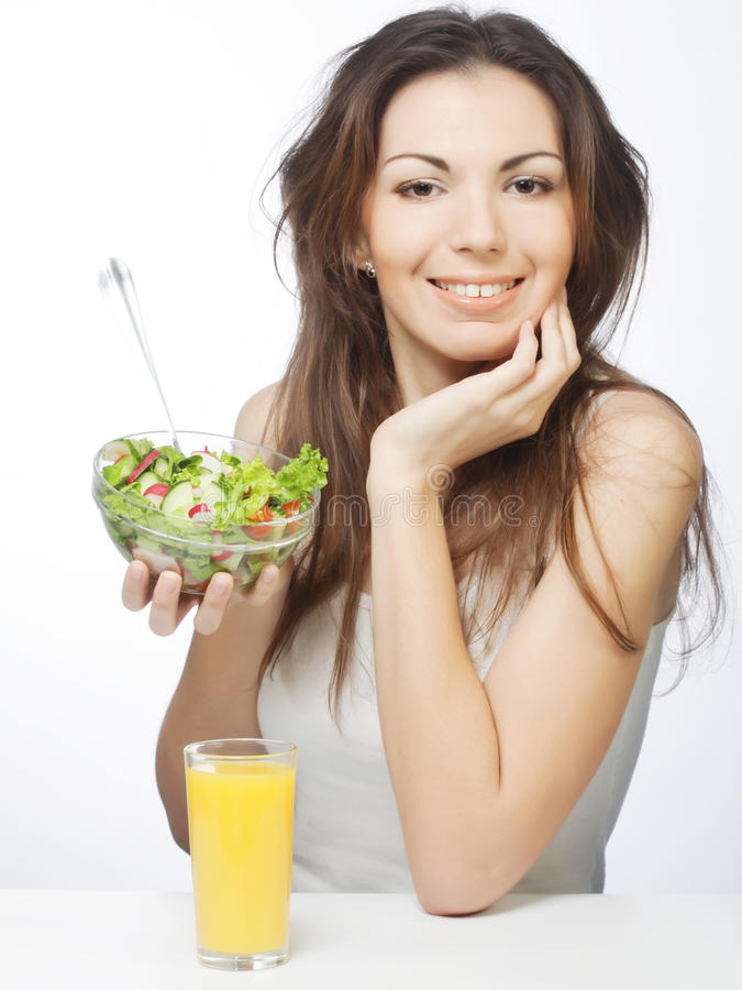 Girl eating healthy food royalty free stock photos