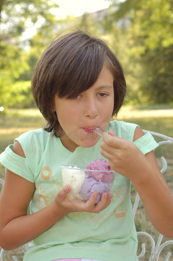 Girl eating ice cream stock photo