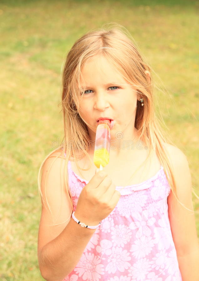 Girl eating ice-cream royalty free stock photography