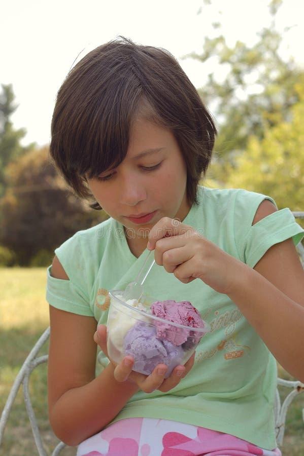 Girl eating ice cream outdoors royalty free stock photos