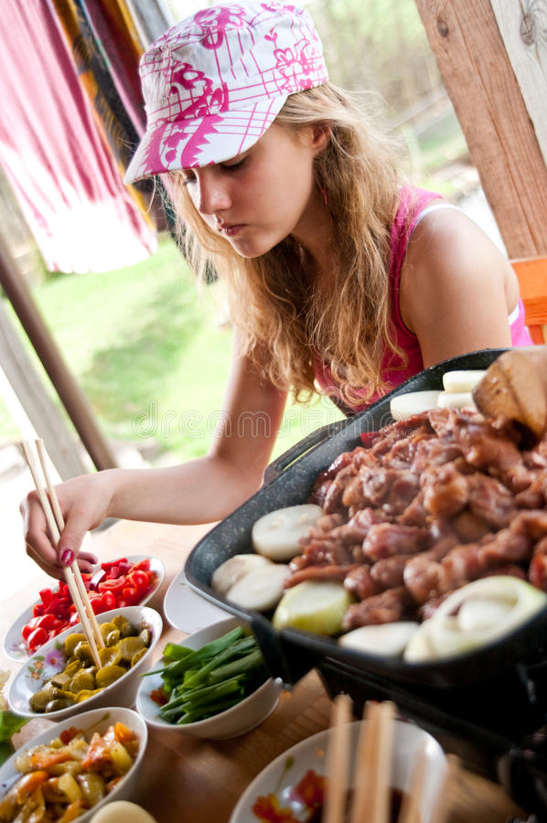 Girl eating Korean food stock image