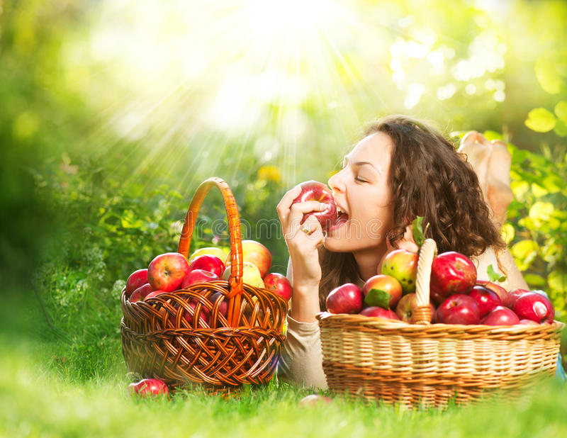 Download Girl Eating Organic Apple In The Orchard Stock Image - Image: 26733859