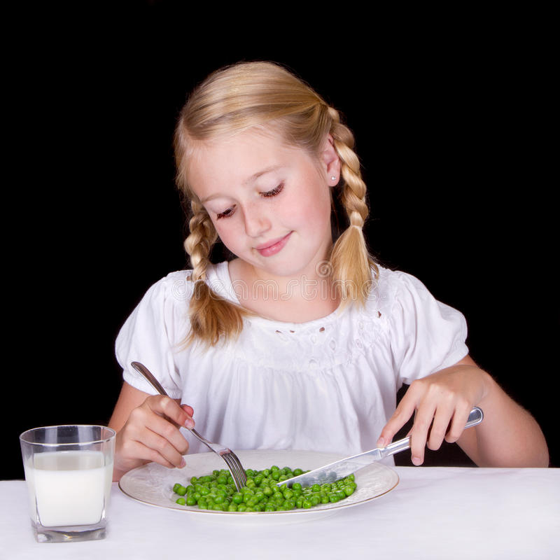 Download Girl Eating Peas Stock Photography - Image: 25952602