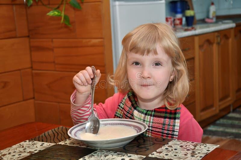 Download Girl is eating porridge stock photo. Image of nice, cream - 26636216