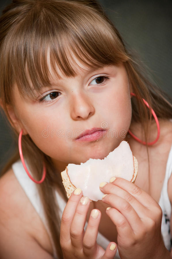 Girl Eating Sandwich Royalty Free Stock Images
