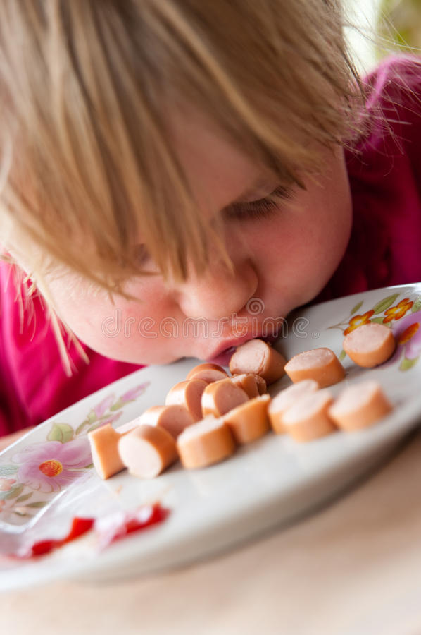 Download Girl eating sausages stock image. Image of hungry, lunch - 24741941