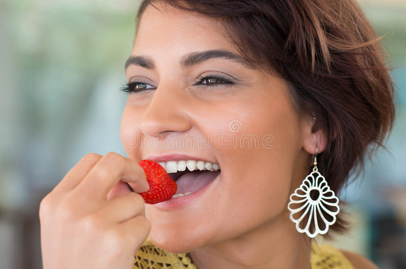 Girl Eating A Snack stock images